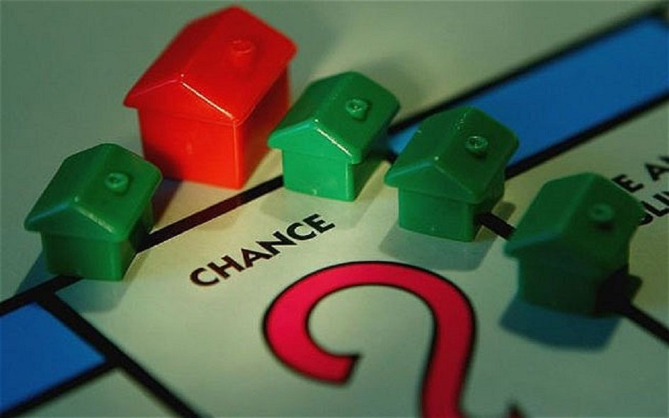 Buy-to-Let Mortgage Interest. Monopoly Houses in red and green on a Monopoly board on the Chance square.