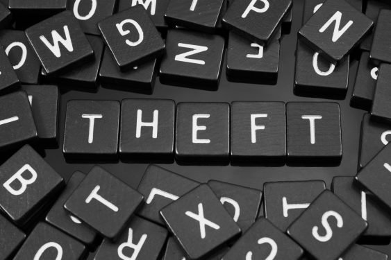 The word Theft in capitals in white letters on black tiles
