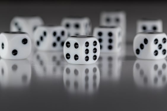 Multiple white dice on a grey background